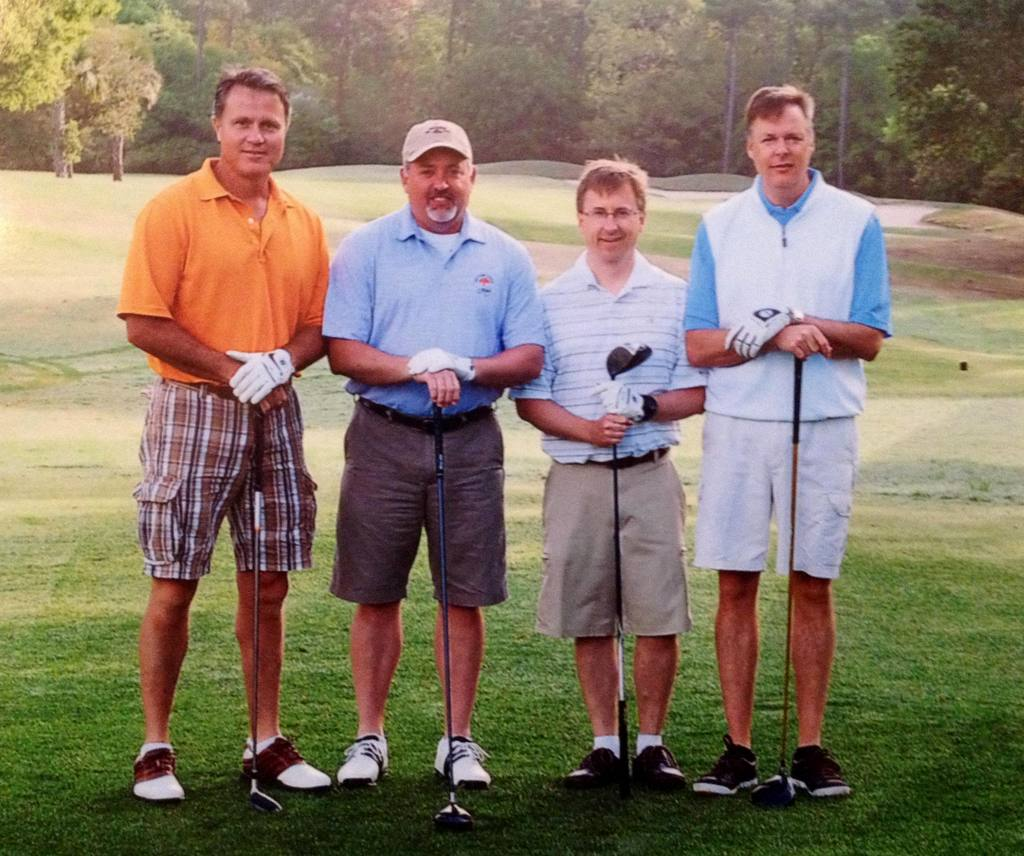 "Kent Manning and his regular, non-slowpoke foursome. Kent is the guy holding his club upside down--""kind of a microcosm of my game, actually."""