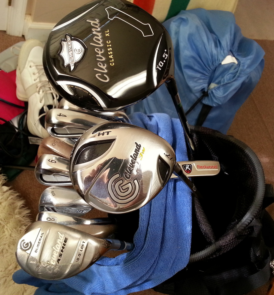The first thing I notice about McQueen's golf clubs is that he keeps them a hell of a lot cleaner than I keep mine.