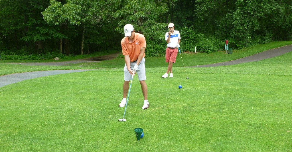 Kevin and Addison preparing to hit their 3-woods farther than Tony and I can hit our drivers.