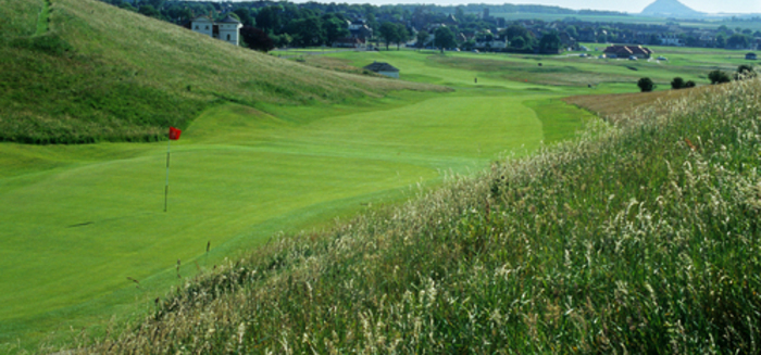 First green, Gullane No. 1, looking back toward town. The knobby thing at  top right overlooks North Berwick and is visible in the photo with the rainbow, below.