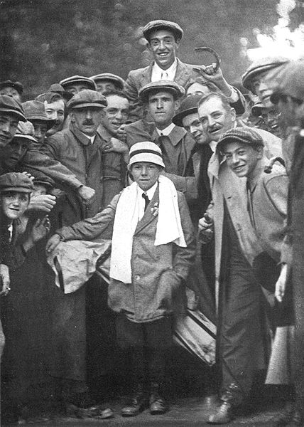 Francis Ouimet (with horseshoe) and Eddie Lowery (with towel and seven-club golf bag), The Country Club, September 20, 1913.