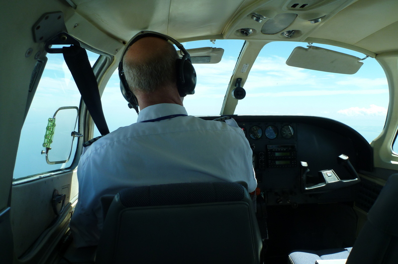 This was our pilot. He never asked me to take the controls, but I studied them, just in case, when I wasn't scanning the ground for golf courses.