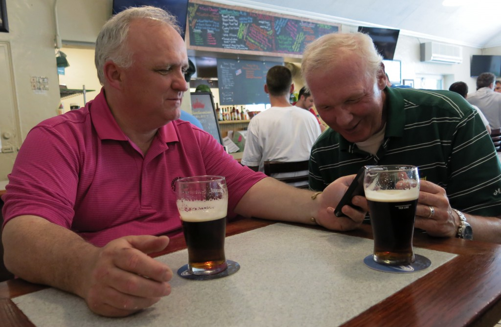 Jim Coleman (left), showing a friend the video below, George Wright Golf Course, Boston, May, 2013.