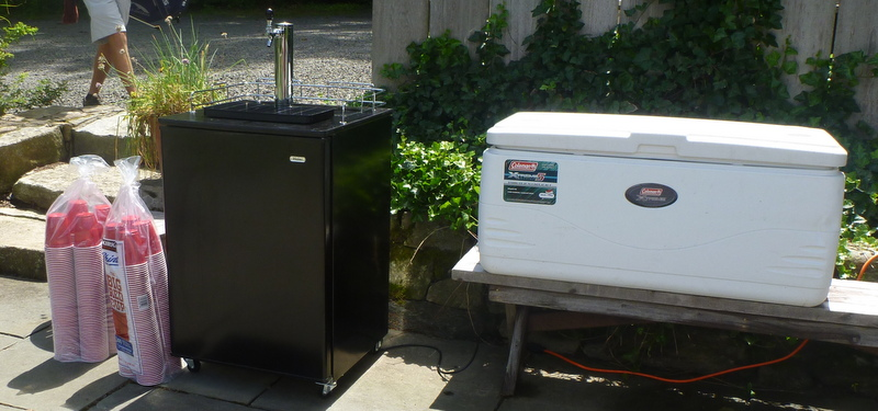 From left to right: plastic beer cups, Kegerator, ice chest containing non-beer-type beverages.