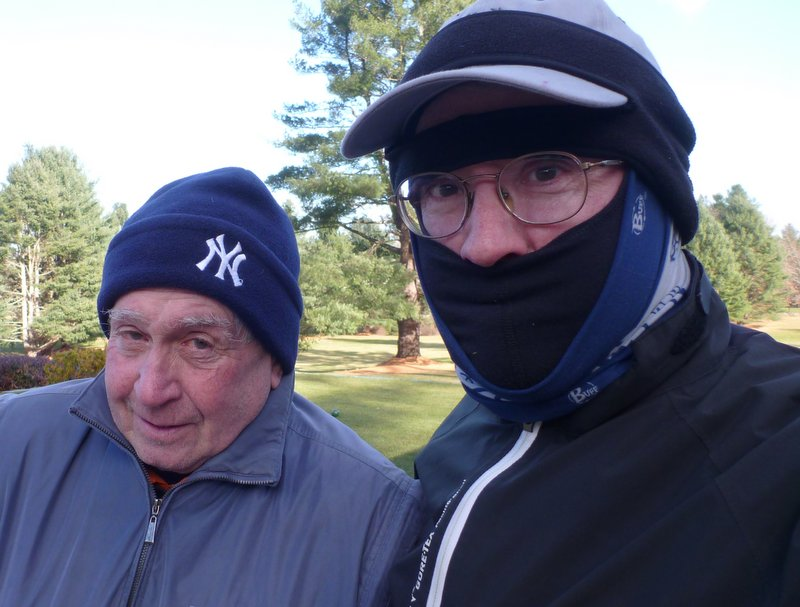 This was a very cold day. Hacker (real name) looks cold because he's wearing just his Yankees knit cap, but I'm wearing a skier's balaclava; a regular golf cap; a Duluth Trading Company eara band with
