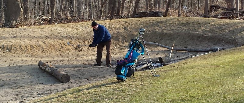 Mike A. attempting a rare steeplechase bunker shot. Degree of difficulty: 10.