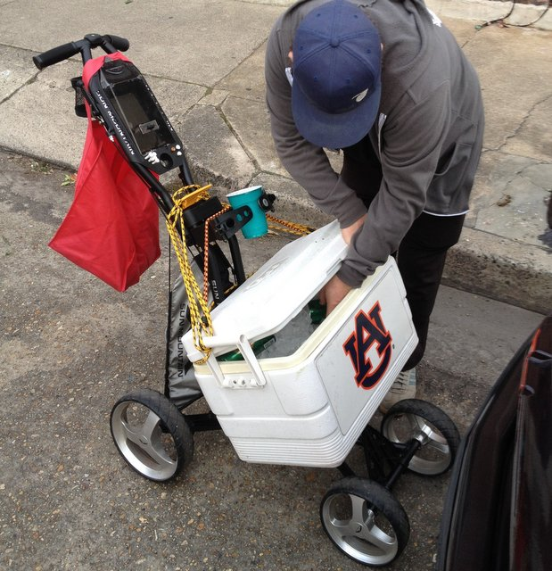 Beer cart co-inventor Spencer, with test load. Note the innovative use of the golf-bag stabilizer arms as a super-secure articulated cup holder. Also note that the cart is still furnished with golf tees, just in case.