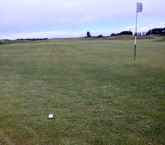 Fourth green, Carnoustie. The white stuff on the ground (not the ball) is hail.