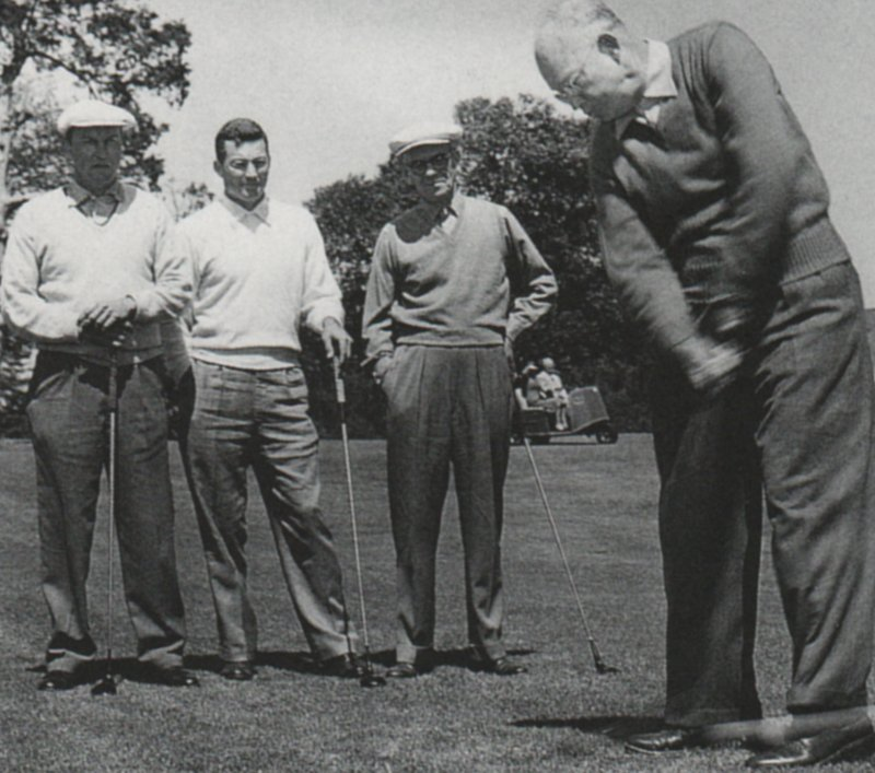 That's Eisenhower swinging, and Bill Zimmerman, Billy Joe Patton and Roberts looking on. Nobody seems impressed by the President's swing.