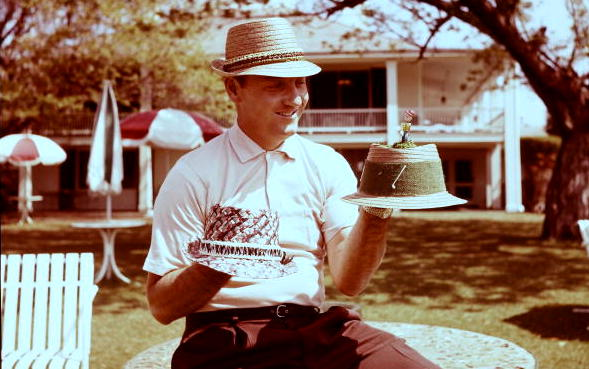 Augusta National/Getty Images Gene Stout showing off samples of his tournament merchandise at the 1962 Masters.