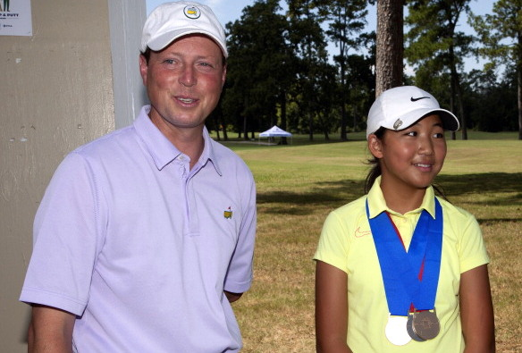 J.J. Weaver and Christine Wang, who won the girls' 12-13 division of a regional round of the Drive, Chip and Putt in 2013. (Bob Levey/Getty Images)