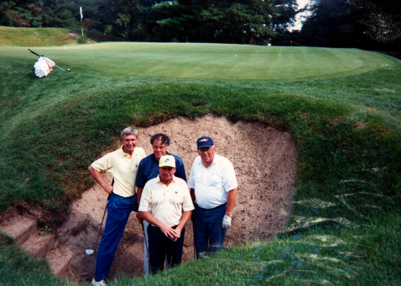 Harry (far right) in the Devil's Asshole, in front of the tenth green at Pine Valley, at some point in the late 1980s or early 1990s, with Rick, John A. (their host), and Hacker.